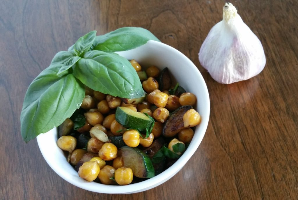 bowl with chickpea zucchini garlic basil saute