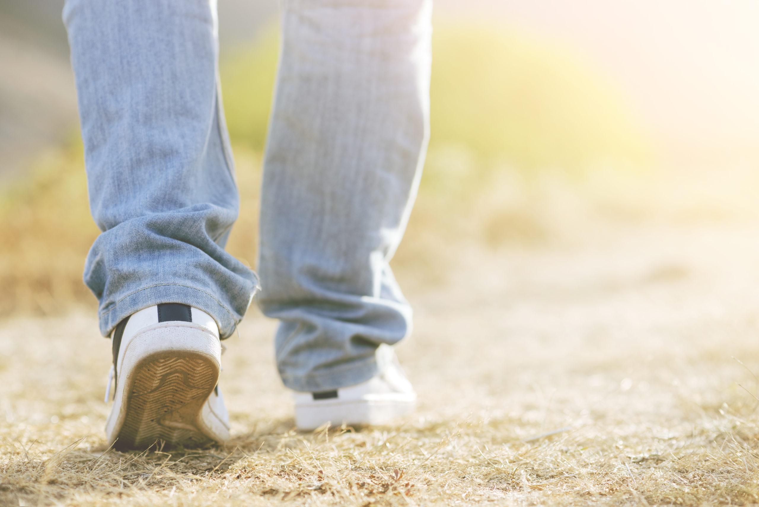 walking feet wearing sneakers