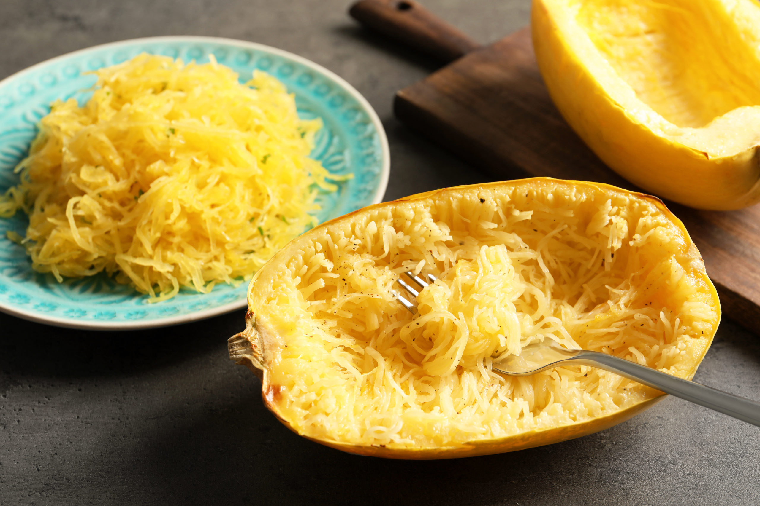Cooked spaghetti squash and fork on table